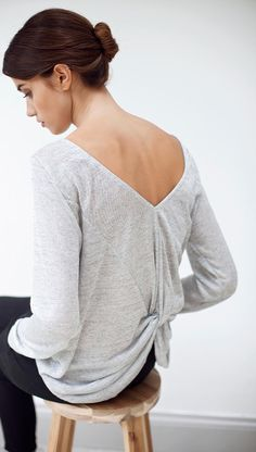 Luxe up your casualwear with our Metallic Twist Back Top. Featuring a twist back and the finest of fabrics, this Metallic Top is your slip on and go staple.