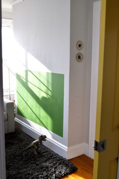 instead of using a growth chart, hang silhouettes of the kids above space to mark their heights  (done here in their playroom)    ducksinarowevents.blogspot.com