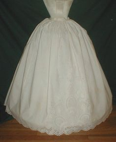 "Beautiful 1860's Cotton Eyelet Petticoat Museum de Accessioned | eBay seller fiddybee; front panel & hem decorated with eyelet embroidering, tight cartridge pleading at waist, back button closure Waist: 22""; length: 38""; hemline width"" 138"""