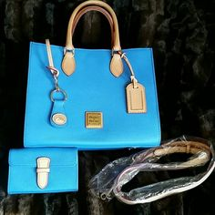 "Dooney & Bourke purse Sky blue, 11 1/2"" W, 9 1/2"" H, 5"" across the bottom.   Comes with a shoulder strap,  matching key fob and matching change purse or lipstick holder.  Brand new as in had never been used.   Also comes with the dust bag.  Beautiful bag and a great color with spring just around the corner. Dooney & Bourke Bags Shoulder Bags"