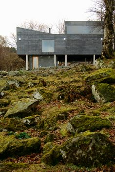 At the edge of a farm at Rennesøy outside Stavanger, this modest house makes use of the ruins of a pigsty as the foundation for a new structure.