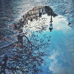 """Amsterdam in a puddle""   One of my very favorite ways of capturing a city is through a #puddlegram. It adds some mystery to the picture. Sometimes you can add interest by positioning the picture up-side-down as well;)   picture and post by @Marianne Hope"