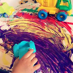 Painting with Trucks | Clare's Little Tots #messyplay #painting #toddlerplay