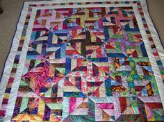 "SPIRAL STRIPS QUILT     Kaffe Fassett's vibrant, glowing use of colour in his designs and bought two jelly rolls of his fabric, one bright and one light. pattern is Pam and Nicky Lintott's book, ""Jelly Roll Quiilts"". I just quilted  ""in the ditch"" (or, in some places, ""near the ditch"" -"