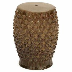 "Textured ceramic garden stool with a brown glaze finish.   Product: Garden stoolConstruction Material: CeramicColor: BrownDimensions: 18"" H x 13"" DiameterCleaning and Care: Wipe with dry cloth"