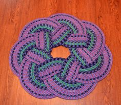 7 Petal Crafted Rug From Recycled Rock Climbing Rope.