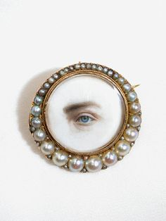 Georgian 'Lover's Eye' miniature portrait brooch surrounded by pearls Eye Jewelry, Jewelry Art, Jewelry Accessories, Jewelry Design, Victorian Jewelry, Antique Jewelry, Vintage Jewelry, Vintage Clothing, Lovers Eyes