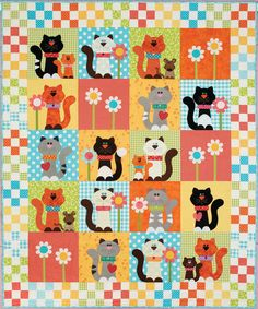 Purrrfectly Pretty Kitties quilt: This adorable quilt features pretty kitties playing in a garden of flowers and Nine Patch blocks. Pattern is included in the book Happy Quilts! by Antonie Alexander.