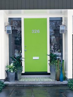 """It's hard to resist painting a contemporary door an acidic shade, like this delicious Overt Green by Sherwin-Williams. """"The simplicity of the door — which isn't interrupted with panels, windows or other details — acts as a great blank canvas to apply bold color,"""" Jackie says."""