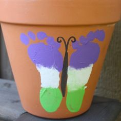 Backyard Butterfly Bin | AllFreeKidsCrafts.com  What a personalized way to have a keepsake of your child or grandchild's feet.