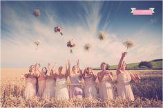 ©rachel lambert photography bridesmaids throwing bouquet rosedew farm farmers barn llantwit major cardiff south wales wedding