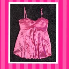 Cute PINK stylish satin tank top Here is a cute pink satin tank top in size Large, this top is in good condition!,no stains, rips or fades!,Price is FIRM on sale itemsto save 15% on 3+ on my clothing items & pay 1 shipping cost❌NO TRADES❌Thank You Tops Tank Tops