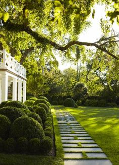 Staggered walkway pavers, and layered shrubbery - small squared off boxwood, small rounded boxwood, larger rounded boxwood