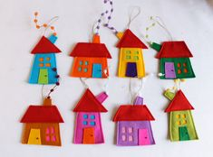 Set of eight houses ornaments. Felt House decoration for all seasons. Different and fun ornaments for your room or your kids. Very colorful. Decoration for wall hanging as well. Room decor for children. Holiday gift for everyone too. House measures aproximate: 3.5 - 5 (9 cm - 15 cm) Hanging measures aproximate.: : 7 - 9 (18 cm-22 cm).