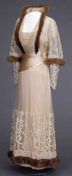 Evening Dress 1916...Wow pretty, Love the trim, imagine this in white/cream real or faux fur. Recreate those details that fit your style. Ask your dressmaker for suggestions.