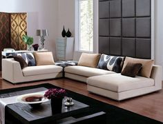 This is more on the traditional living room design, cream and charcoal colored furniture give it a more comfortable feel.