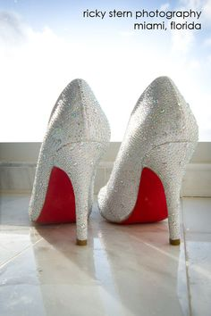 White Louboutin wedding heels adorned with hundreds of rhinestones and signature red bottoms.  www.miamiphotographer.net