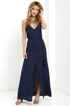 Take a deep breath and enjoy an effortless day spent in the Fresh Air Navy Blue Maxi Dress! Soft woven fabric drapes from adjustable spaghetti straps into a V neckline and low sloping back. Tasseled waist tie threads through belt loops above a maxi skirt with center slit. Hidden back zipper with clasp.
