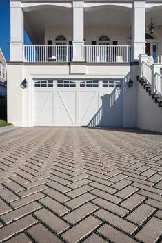 The Travertina paver, a permeable paving solution gives your driveway and outdoor paths great looks while being ecologically responsible and anti-flooding ready. Driveway Entrance Landscaping, Driveway Design, Paver Stones, Paths, Garage Doors, Backyard, Driveways, Landscape, Outdoor Decor