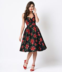 Send her roses! This fantastic vintage dress is fresh from Hell Bunny in a retro red rose floral throughout. A halter style swing, the Cannes dress is accented with a thickly banded and nipped in waist, smocked back panels for a comfortable fit and full c