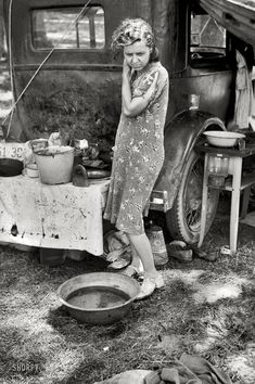 "July 1940. Berrien County, Michigan. ""Migrant mother of family from Arkansas in roadside camp of cherry pickers."""
