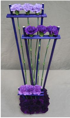 Unknown designer contempary design with carnations can duplicate this/ www.callaraesfloralevents.com