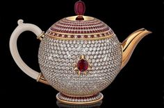 The most expensive teapot in the world ~ the teapot was made by the Milanese jeweller Scavia. It is entirely paved in D and E colour grade diamonds and 386 rubies, with a central carat Thai ruby. A ruby bead tops the lid. Sparkling Diamonds, Ruby Beads, Teapots And Cups, Most Expensive, Tea Service, Chocolate Pots, My Tea, Tea Time, Vases