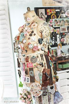 I love vintage dress forms especially when adorned with vintage pins. Oh so lovely.