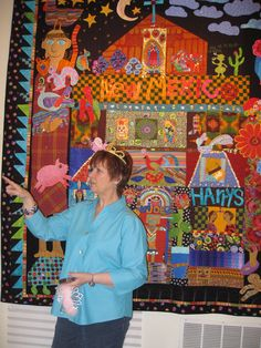 Mary Lou explaing her New Mexico quilt- lots of color and milagros too