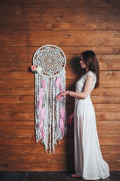 Boho dreamcatcher with pink feathers to add a bohemian vibe to your home. Check out more of your handmade beauty at www.etsy.com/bohodaisystudio