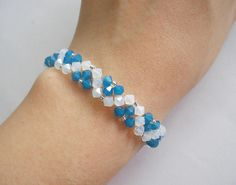 This bracelet tutorial includes details, easy step by step instructions with colour photos/pictures and materials list. The bracelet is made using Swarovski bicone and seed beads, which are easily available. Time required approximately 2 hr Number of pages 13 Number of Steps 32 Skill