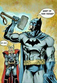 Batman lifts mjolnir.