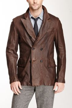"""Wash Leather Peacoat in brown by Billy Reid $1495 - $789 @HauteLook. - Notch collar - Double breasted button closure - Two front flap pockets - One front non-functional chest pocket - Approx. 29.5"""" length - Made in Italy Model's stats:  - Height: 6'1'' - Suit: 40"""" - Waist: 30'' Model is wearing size M. - Dry clean - 100% genuine leather"""