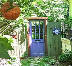 If a gate is just too boring as the entrance to your garden, why not try an old door.  It's a great way to recycle/re-use.