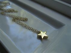 Tiny Gold Star on Gold Filled Chain $20
