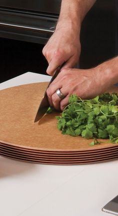 "Bigger really is better in the case of the Epicurean® 18"" Round Carving Block, a cutting board you can't butcher."