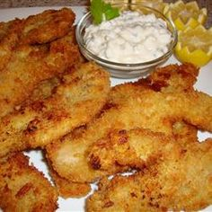 Pan-fried razor clams in a crunchy crust make a tasty shellfish appetizer when breaded with coarse Japanese panko bread crumbs. Allow enough additional time before cooking to freeze breaded clams so the coating sticks well. Clam Recipes, Seafood Recipes, New Recipes, Dinner Recipes, Cooking Recipes, Recipies, Favorite Recipes, Asian Recipes, Mussel Recipes