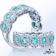 We're enjoying this Monday with an unique 7 stone paraiba oval and diamond band