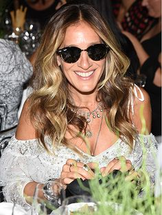 Sarah Jessica Parker sports clubmaster-inspired round shades at an award party in NYC.