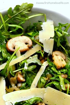 Earthy herbedmushrooms mixedwith baby arugula, tossed in a light lemon vinaigrette, and topped with long paper thin shavings of salty Parmesan. This makes getting bored of eating salad almost impossible!  Caesar, Greek, blue cheese wedge…I'm always looking for new salads to make.