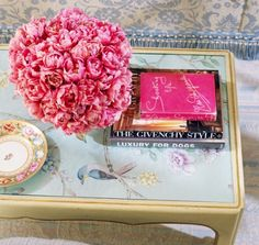 Coffee table with hand painted wallpaper panel styled with pink peonies