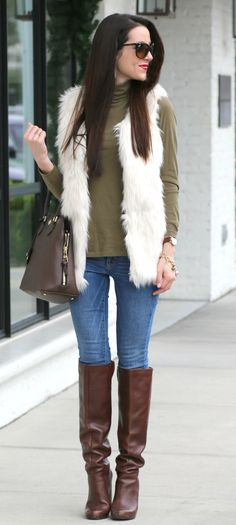 Cream faux fur vest with a neutral sage turtleneck, light wash skinny jeans, and tall brown boots. Such a cute fall or winter outfit idea.