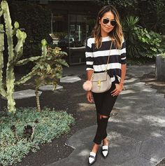 Julie Sarinana plays matchy-matchy with her striped top and Céline loafers. Image Source: instagram user si...