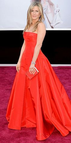Jennifer Anniston looking red hot in Valentino...obsessed with this youthful look. #Oscars. #RepinToWin