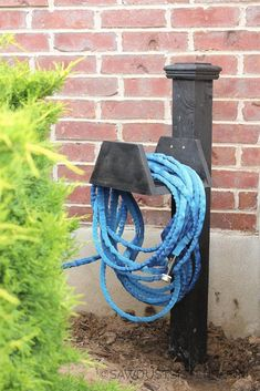 Make a cute and chunky DIY wood garden hose holder. Step by Step tutorial with plenty of detail and photos. No more tripping over your garden hose!