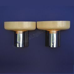 Great looking and unusual pair of mid to late 30s vintage Art Deco wall sconces made by Lightolier. These antique lighting fixtures have original custard glass and have been refinished with an exact match to the original dark Burgundy color of the back plates. The chrome socket surrounds have been polished to a high luster and are in excellent condition with no dents.  http://www.vintagelights.com/product/4/pair-1930s-art-deco-moderne-sconces-with-custard-glass-shades-3rd-available.html