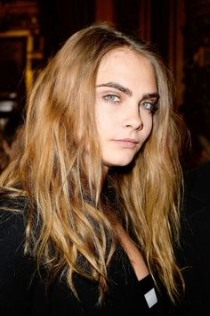 Cara Delevingne attends the Stella McCartney show as part of the Paris Fashion Week Womenswear Fall/Winter 2015/2016 on March 9, 2015 in Paris, France.