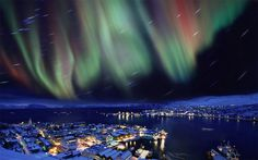 Aurora Borealis (northern lights) over city of Hammerfest, Northern Norway. Photo by: Alamy