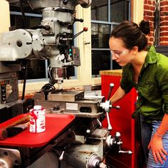 Stanford engineer Agatha Bacelar working at a mill in the #Stanford Product Realization Lab.