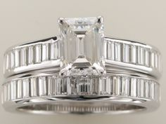 Custom made bridal set with 1ct emerald cut diamond center and 50 baguettes in engagement and wedding band